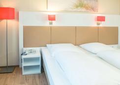 Hotel Stuttgart Sindelfingen City by Tulip Inn - Зиндельфинген - Спальня