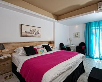 Drossia Palms Hotel and Nisos Beach Suites - Mália - Bedroom