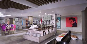 The Vasini Hotel - דנפסאר - מסעדה