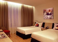 Fox Hotel Pekanbaru - Pekanbaru - Slaapkamer