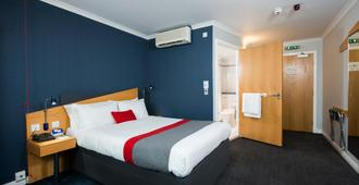 Holiday Inn Express Glasgow - City Ctr Riverside - Glasgow - Phòng ngủ