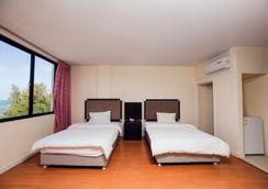 Gold Beach Hotel - Garapan - Bedroom