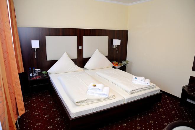 Hotel Neugrabener Hof - Hampuri - Makuuhuone