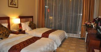 Siji Junshang Hotel - Dalian - Bedroom