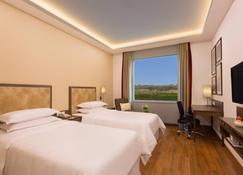Four Points by Sheraton New Delhi Airport Highway - Нью-Делі - Bedroom