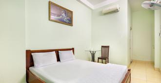 OYO 752 Mat Troi Vang - הו צ'י מין סיטי - חדר שינה
