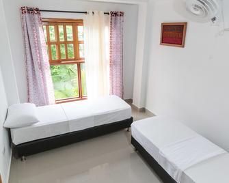 Hotel Doña Triny - Capurgana - Bedroom