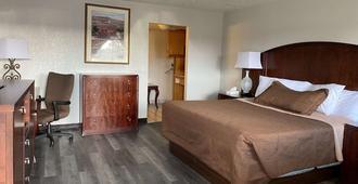 Travelodge by Wyndham Farmington Hwy 64 - Farmington - Bedroom