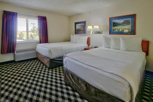 MCM Elegante Suites - Colorado Springs - Bedroom