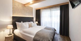 Chalet Grumer Suites&Spa - Ritten - Schlafzimmer