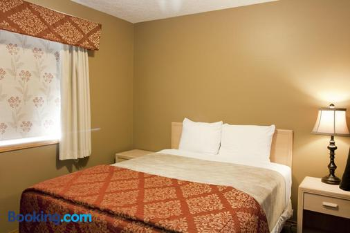 Bow River Inn - Cochrane - Bedroom