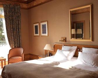 Grand Hôtel- Domaine De Divonne - Дівонн-ле-Бен - Bedroom