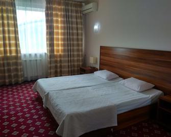 Silk Way Hotel - Aqtau - Slaapkamer