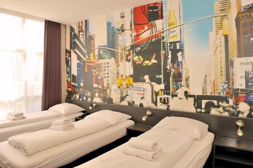 Budget Hotel Tourist Inn - Amsterdam - Makuuhuone