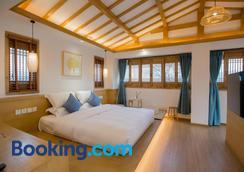 Jianshe Inn - Lijiang - Bedroom
