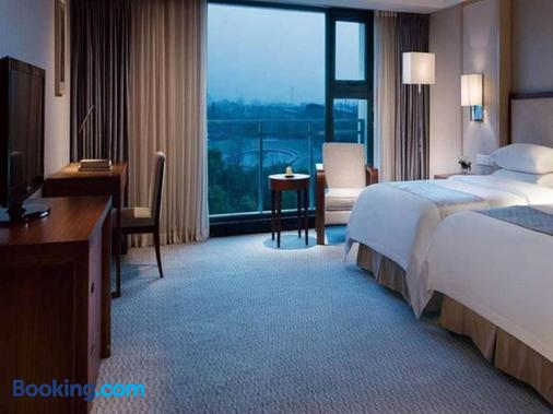 Jinling Riverside Hotel Nanjing - Nam Kinh - Phòng ngủ