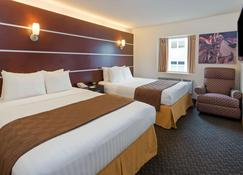 Days Inn & Suites by Wyndham Milwaukee - Milwaukee - Sypialnia