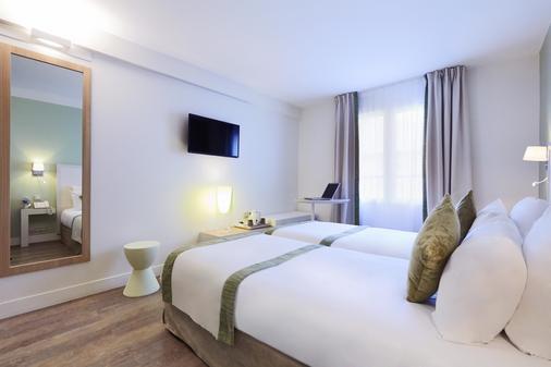 Kyriad Paris 18 - Porte de Clignancourt - Montmartre - Paris - Phòng ngủ