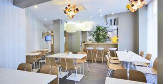 Kyriad Paris 18 - Porte de Clignancourt - Montmartre - פריז - מסעדה