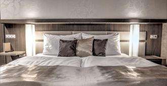 Volcano Spa Hotel - פראג - חדר שינה