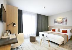 Kyriad Prestige Vannes Centre - Palais Des Arts - Vannes - Bedroom