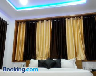 Makil House - Neeleshwar - Slaapkamer