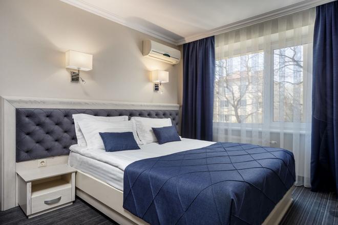 Eurohotel - Lviv - Phòng ngủ