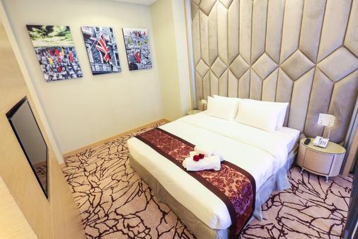 Eco Tree Hotel - Malakka - Schlafzimmer