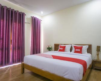 OYO 1696 Sapo Rumbia - Berastagi - Bedroom