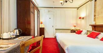 Hôtel Saint Etienne - קאה - חדר שינה