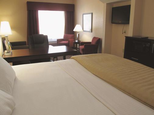 梅肯西拉昆塔旅館及套房酒店 - 馬孔 - 梅肯 - 臥室