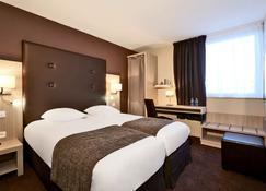 Kyriad Prestige Dijon Nord Valmy - Dijon - Bedroom