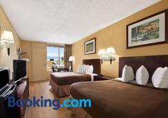 Howard Johnson by Wyndham Airport Florida Mall - Orlando - Bedroom