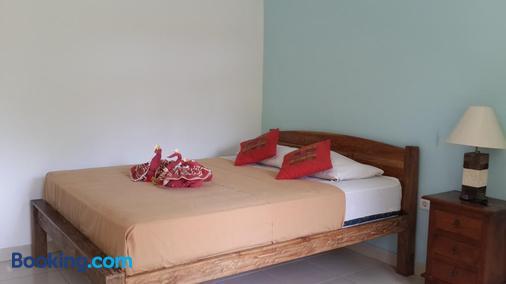 Medori Putih Homestay - South Kuta - Bedroom