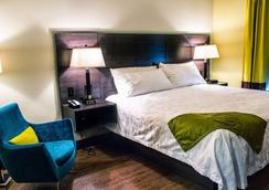 Malana Hotels & Suites - Cotulla - Schlafzimmer