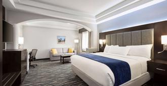 Days Inn & Suites by Wyndham Houston Hobby Airport - יוסטון - חדר שינה