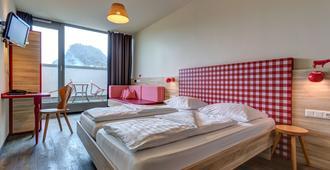 Meininger Hotel Salzburg City Center - Salzburg - Phòng ngủ
