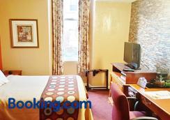 Midtown Inn - Baltimore - Phòng ngủ