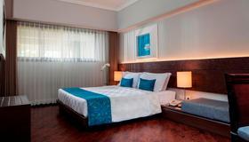 Prime Plaza Suites Sanur - Bali - Denpasar - Phòng ngủ