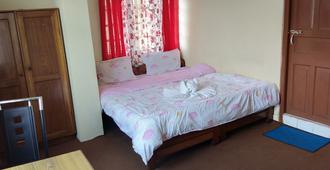 Hotel Panda International - גנגטוק - חדר שינה