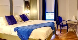 The Ridge Hotel - ניו יורק - חדר שינה