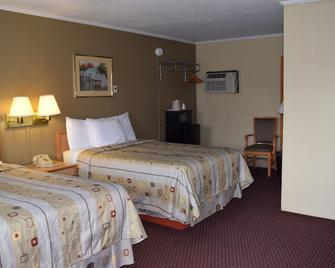 Economy Inn - Taylorville - Спальня