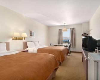 Travelodge by Wyndham Brooks - Brooks - Спальня