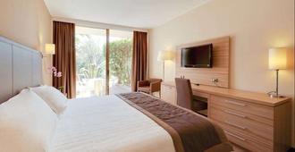 Nyala Suite Hotel Sanremo - San Remo - חדר שינה