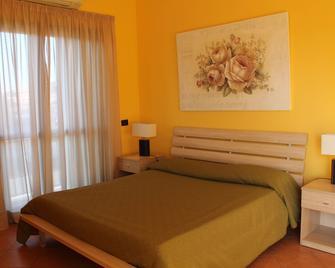 La Maison Jolie - Fiumicino - Schlafzimmer