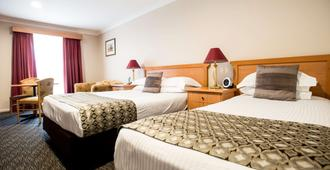 Best Western Plus All Settlers Motor Inn - טמוורת' - חדר שינה