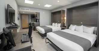 Hotel & Suites Le Dauphin Quebec - קוויבק סיטי - חדר שינה