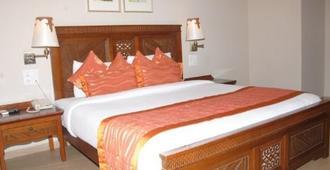 Sai Palace Inn - Mumbai - Schlafzimmer