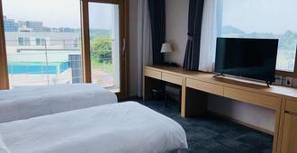 The Best Jeju Seongsan Hotel - Seogwipo - Bedroom