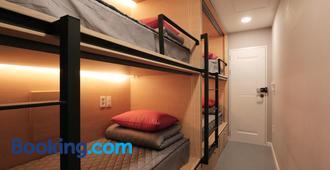 慶州藍艇青年旅館 - 慶州 - 臥室